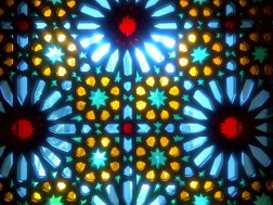 Stained glass windows cast off a dramatic lights during night at the prayer room.