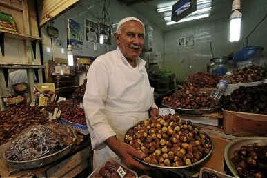 A vendor in Kuwait selling Dates