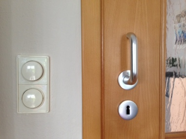 Round light switches and round old-fashioned key holes. In Germany, door knobs don't turn so always bring your key when you go out!